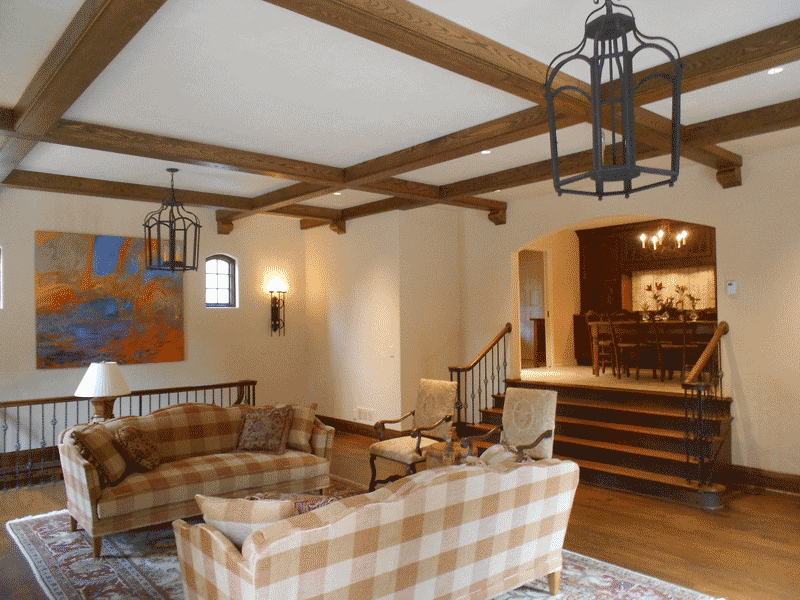 Greatroom - ceiling beams and stair to house.